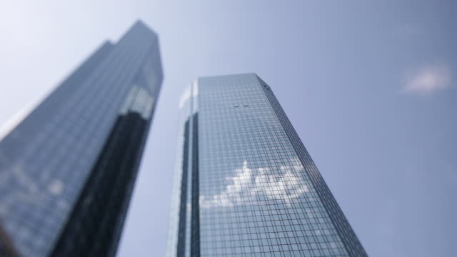 eurotower building reflecting sky and clouds frankfurt am main hessen germany on monday july 1 2019 - deutsche bank stock videos & royalty-free footage