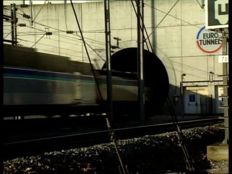 eurotunnel financial crisis: annual meeting held in calais; t06059405 ???: ext eurostar train along tracks train away into eurotunnel air view train... - 年次総会点の映像素材/bロール