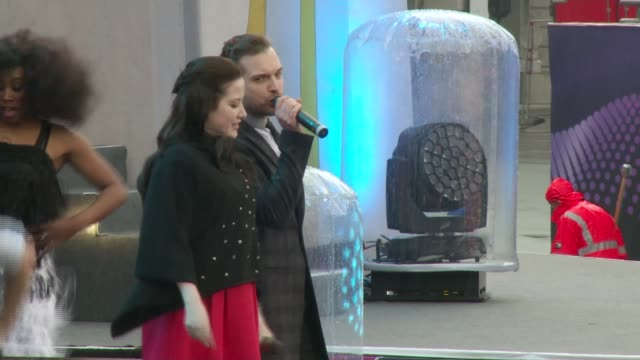 eurovision song contest 2015: electro velvet fly flag for uk; location unknown: ext **music heard sot** various of electro velvet performing on stage - eurovision song contest stock videos & royalty-free footage