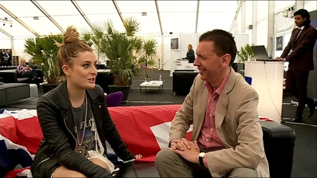 eurovision song contest: preview; molly smitten-downes sitting with reporter during interview - eurovision song contest stock videos & royalty-free footage