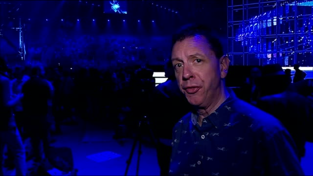 eurovision song contest: preview; reporter to camera european nation flags waved from stage during rehearsal - eurovision song contest stock videos & royalty-free footage