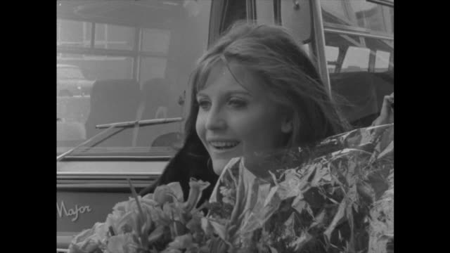 sandie shaw arrives home brenards england london lap sandie shaw with flowers by coach walks off bv sandie shaw away with group of people including... - eurovision song contest stock videos & royalty-free footage