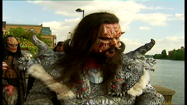 eurovision song contest winners 'lordi' interview lordi band members stand in pub garden drinking beer with straws close shot of demonic face of one... - eurovision song contest stock videos & royalty-free footage