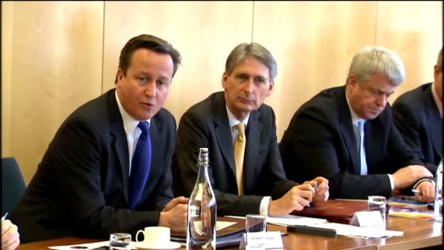 Angela Merkel and Nicolas Sarkozy agree EU reform downgrade threat Suffolk Ipswich BT Research Building INT David Cameron Philip Hammond MP and...