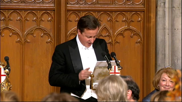 David and Samantha Cameron arrive at Guildhall and Cameron speech Hall seen from above / David Cameron MP speech SOT Jokes about being dressed for...