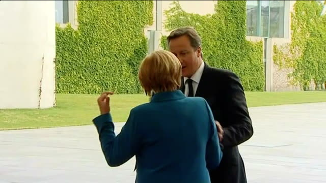 david cameron meets angela merkel for talks in berlin; germany: berlin: ext david cameron mp out of car and greeted by angela merkel int angela... - no doubt band stock videos & royalty-free footage