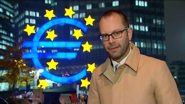 germany opposed to european central bank intervention frankfurt reporter to camera close shot face of man men sitting on bench hans jaeckel setup... - speichen stock-videos und b-roll-filmmaterial