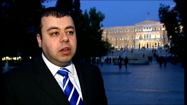 vídeos y material grabado en eventos de stock de greek cabinet backs referendum on bailout terms; ext / evening crowd along busy street azad zangana interview sot - could be talking about 60 to 80... - devaluation