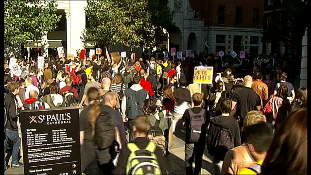 occupy the city protests in city of london; protesters beginning march / - occupy protests stock videos & royalty-free footage