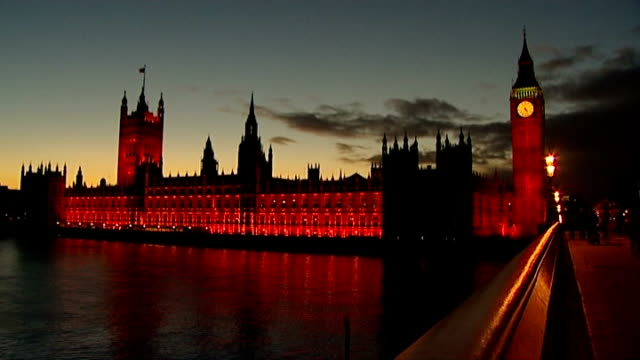 uk isolated after eu summit veto england london westminster ext union jack flag flying over houses of parliament low angle shot of houses of... - westminster bridge stock-videos und b-roll-filmmaterial
