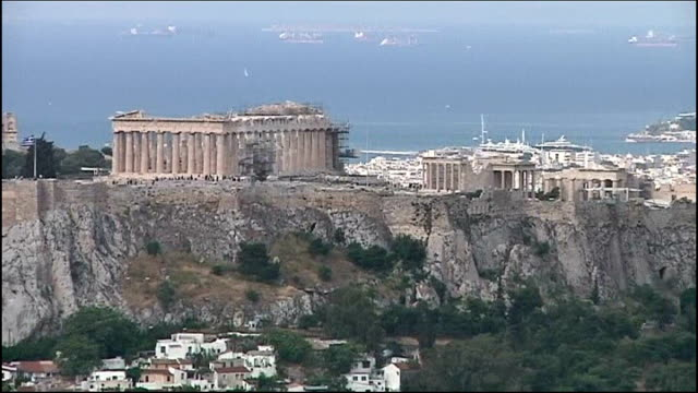 unrest in spain greece athens ext general views of acropolis on athens skyline - acropolis athens stock videos & royalty-free footage