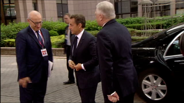 Eurozone leaders reach agreement on Greek debt crisis rescue package BELGIUM Brussels EXT Angela Merkel out of car and looking up at sky as arrives...