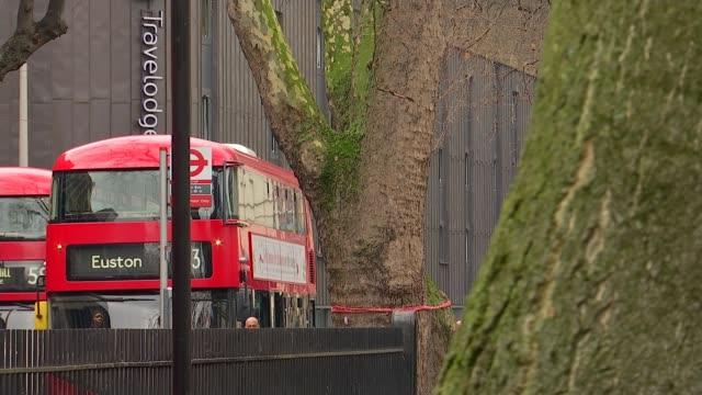 Euston Square Gardens and HS2 protest general views ENGLAND London Euston EXT GVs Euston War Memorial / buses around Euston railway station entrance...