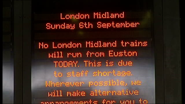 Digital display board notifying travellers of cancellation of London Midland trains due to staff shortage