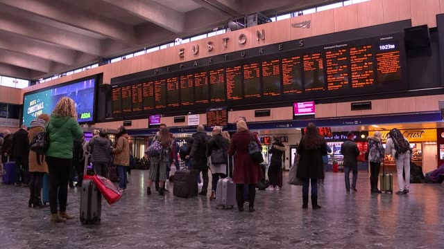 Euston station services cancelled after electrical wires fall onto tracks Passengers queuing on concourse Departures board showing cancellations...