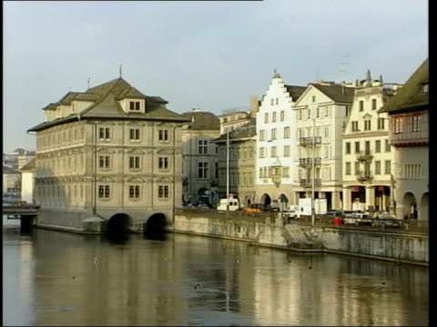 couple travel to switzerland for assisted suicide lib switzerland zurich buildings around lake tram crossing bridge - euthanasia stock videos & royalty-free footage