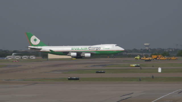 Eva Air Cargo Plane (Boeing 747-400F)  taxis on runway/DFW International Airport, Dallas-Fort Worth, Texas, USA