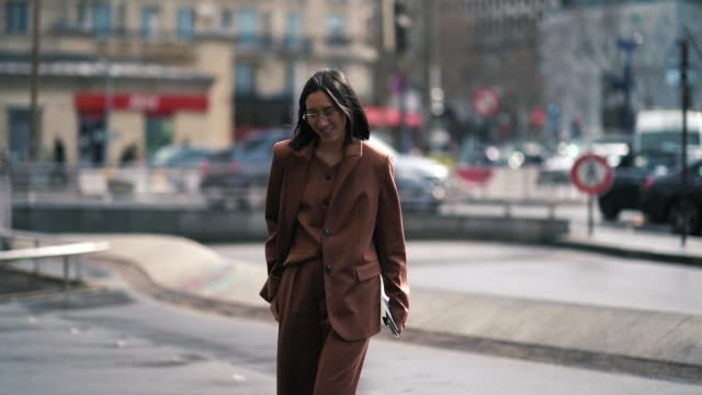 Eva Chen wears a brown threepiece suit wedges shoes outside Giambattista Valli during Paris Fashion Week Womenswear Fall/Winter 2019/2020 on March 04...