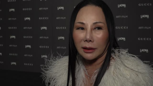 eva chow on why its important for lacma to celebrate art & film, talks about honorees cathy opie & guillermo del toro at 2018 lacma art + film gala... - ロサンゼルスカウンティ美術館点の映像素材/bロール