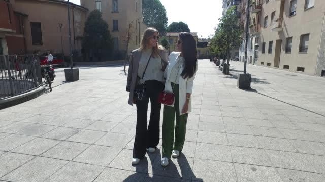 eva deusser wearing zara trousers and blazer hm shirt tiger of sweden sneakers and mykita sunglasses and minu pirzadeh wearing hm trousers and blouse... - blouse stock videos & royalty-free footage