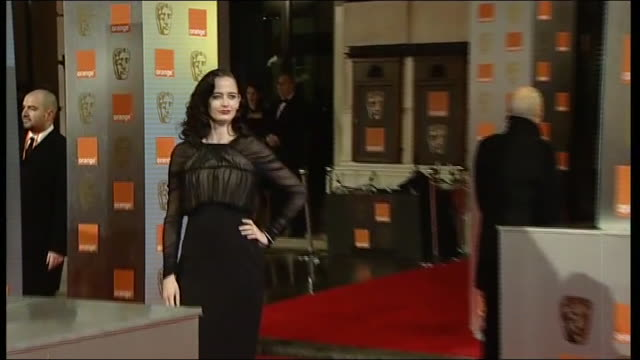 Eva Green poses for press on the red carpet at the British Academy Film Awards 2011