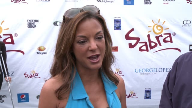 interview eva la rue on being a part of today what she appreciates about george and his philanthropic efforts her golf style at lakeside golf club on... - eva larue stock videos and b-roll footage