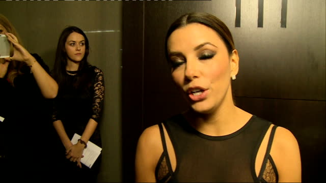 arrivals more longoria being interviewed on red carpet / eva longoria interview sot on victoria beckham dress being in london woman she most admires... - nicole scherzinger stock videos and b-roll footage