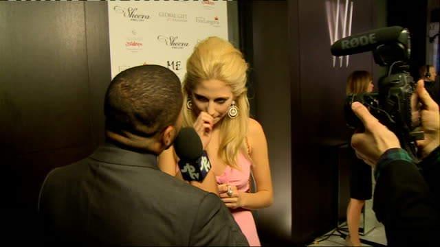 arrivals pixie lott chatting with press on red carpet / pixie lott interview sot - pink singer stock videos and b-roll footage