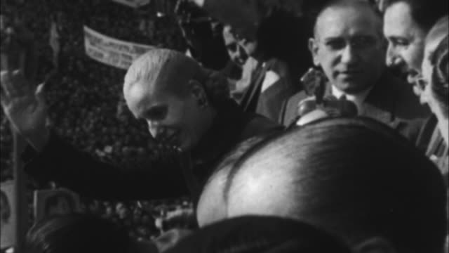 eva peron waving to people from balcony/ argentina - 1946年点の映像素材/bロール