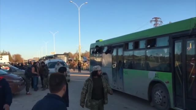 evacuated civilians fled from east aleppo that had been under siege by iranled shiite militias and assad regime forces arrive at a town of idlib... - belagerung stock-videos und b-roll-filmmaterial