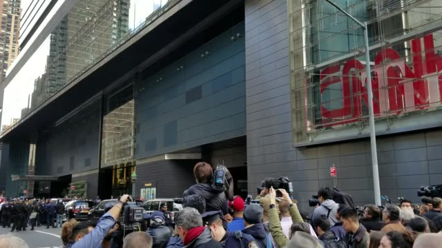 cnn evacuated its new york offices on wednesday after the cable network received a suspicious package that police investigated as an explosive device - cnn stock videos & royalty-free footage