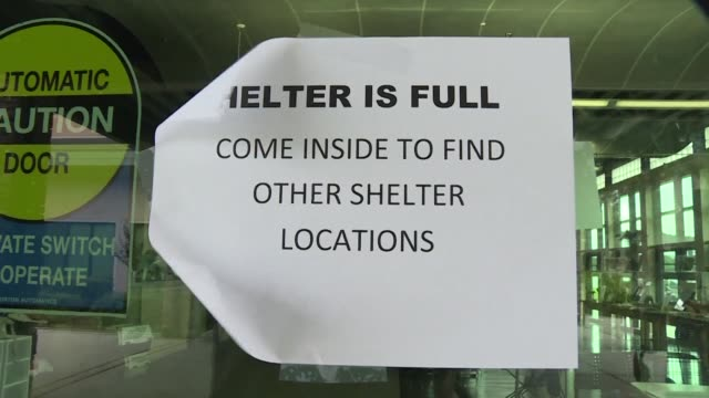 evacuees await the fury of hurricane irma from a designated storm shelter in southwest florida - southwest florida stock videos & royalty-free footage