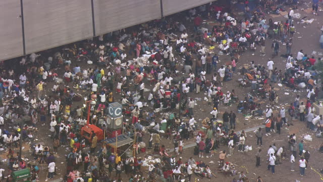 evacuees gathered outside louisiana superdome and awaiting for evacuation / united states - hurricane katrina stock videos and b-roll footage