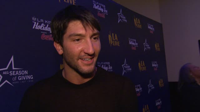 Evan Lysacek on performing at the LA Live Holiday Tree Lighting what the song he sang means to him personally his favorite holiday memory why it's...