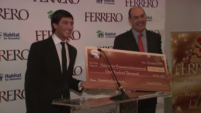 Evan Lysacek presents Ferrero's donation to Habitat for Humanity at the Ferrero Chocolates and Evan Lysacek Fashion Event at New York NY