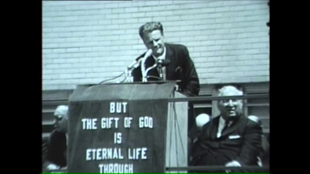 evangelical pastor billy graham preaches to prisoners outdoors in chicago in 1962 - preacher stock videos and b-roll footage