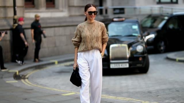 Evangelie Smyrniotaki wearing white pants beige knit is seen outside Erdem during London Fashion Week September 2018 on September 17 2018 in London...