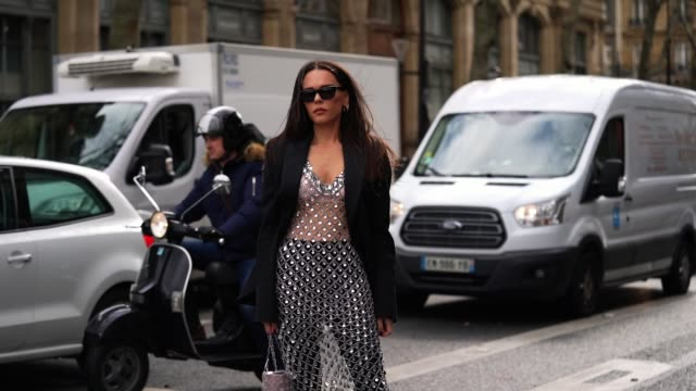 evangelie smyrniotaki wears sunglasses, a black oversized blazer jacket, a bejeweled mesh dress, black leather boots, outside paco rabanne, during... - mesh textile stock videos & royalty-free footage