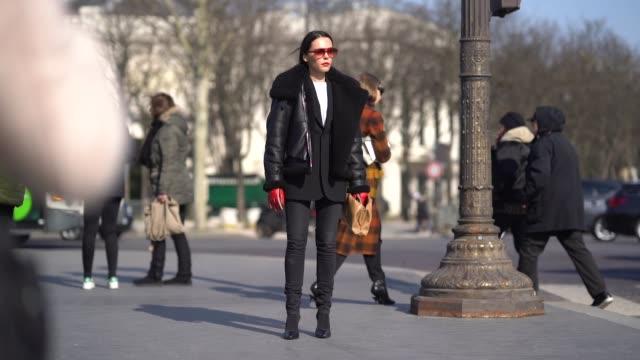 Evangelie Smyrniotaki wears sunglasses an aviator jacket black pants during Paris Fashion Week Womenswear Fall/Winter 2018/2019 on February 28 2018...