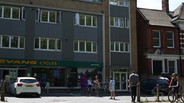 evans cycles in dulwich south london is open again with a one in one out policy spray painted marks in the carpark help customers to keep 2m apart as... - bicycle stock videos & royalty-free footage