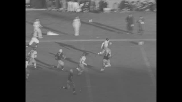 pass intercepted by Northwestern University football team during game against the University of Illinois / Northwestern rusher runs 80 yards for...
