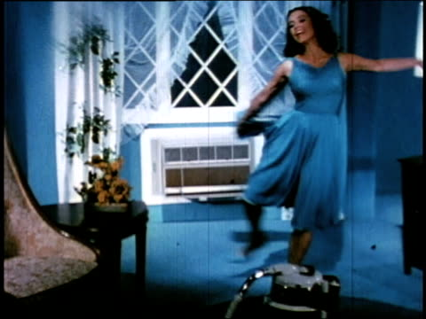 "1966 zo ""eve"" dancing in front of air conditioning vent - air duct stock videos & royalty-free footage"