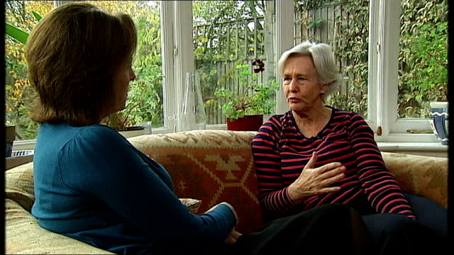 eve of remembrance sunday war dead remembered around the world england int margaret evison interview and setup shots with reporter sot - ジャッキー ロング点の映像素材/bロール