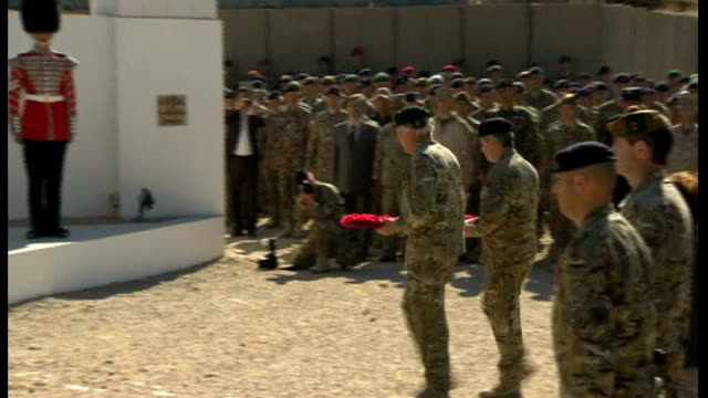 eve of remembrance sunday war dead remembered around the world lib / afghanistan helmand province camp bastion ext **music heard sot** soldiers... - 2001年~ アフガニスタン紛争点の映像素材/bロール