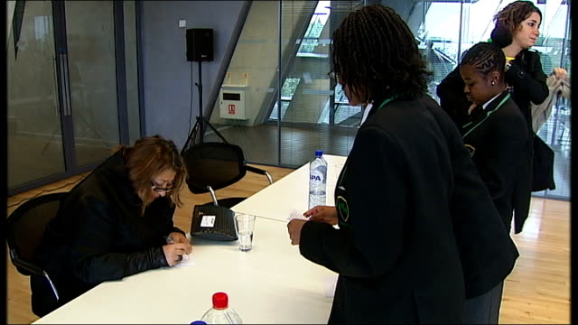 Evelyn Grace Academy wins Stirling Prize for Architecture T16101023 INT Various of Zaha Hadid signing autographs for school pupils