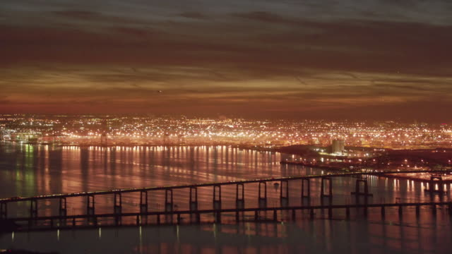stockvideo's en b-roll-footage met evening aerial flying over industrial new jersey with lights on - new jersey