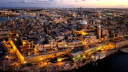 Evening aerial hyper lapse of Valletta old town, Malta