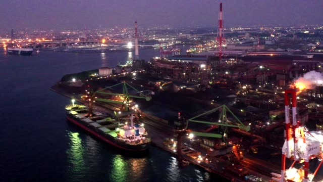 evening aerial view of bayside industrial facilities - social issues点の映像素材/bロール