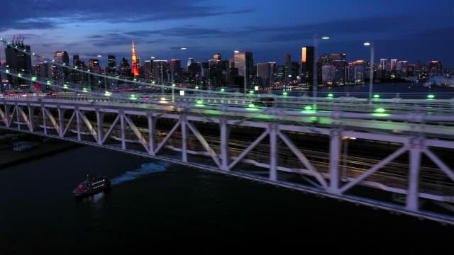 evening aerial view of the rainbow bridge - dusk stock videos & royalty-free footage