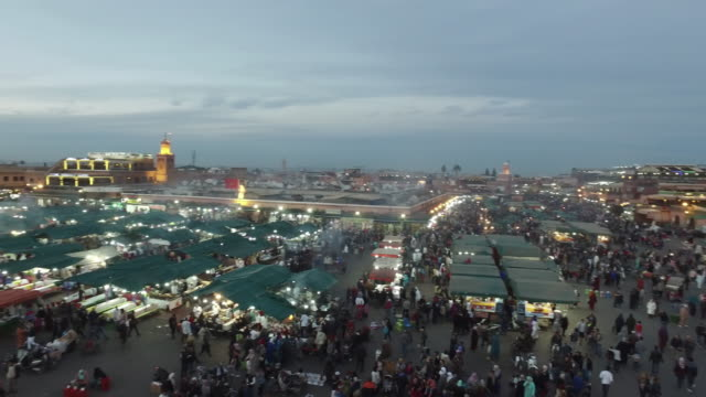 evening djemaa el fna square with koutoubia mosque, marrakech, morocco - souk stock videos & royalty-free footage
